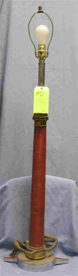 Large antique fire nozzle lamp