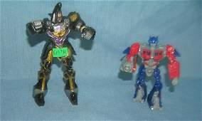 Pair of vintage transformer toys