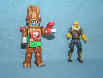 Pair of vintage action figures