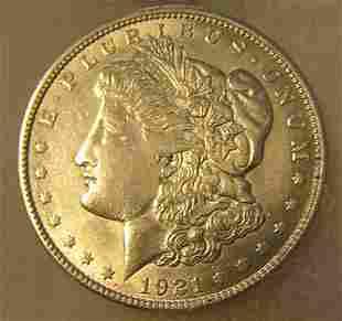 1921 Morgan silver dollar in AU condition