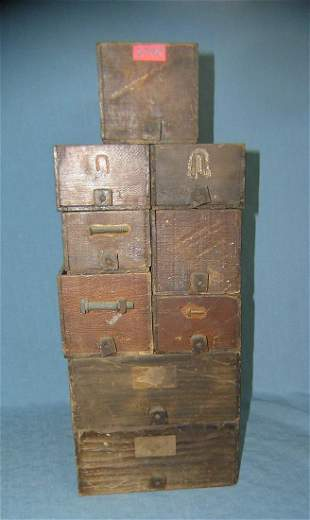 Large group of antique hardware storage boxes