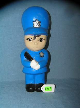 Figural police officer's display piece