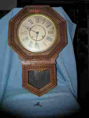 Antique wall clock by Wm L Gilbert Clock Co