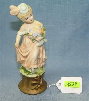 Hand painted porcelain flower girl figurine