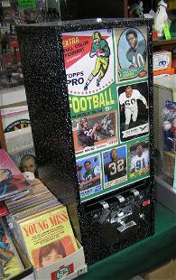 Hockey themed coin operated sports card vending machine