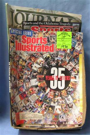 Box of vintage sports collectibles
