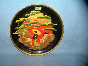 Oriental themed hand painted wall plate