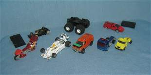 Group of vintage toy cars, trucks and parts