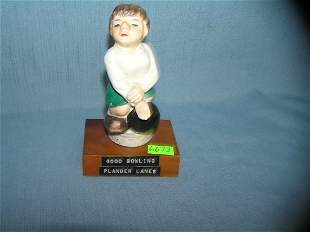 Hand painted porcelain and wood figural bowling trophy