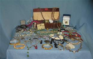 Large box of vintage and modern costume jewelry