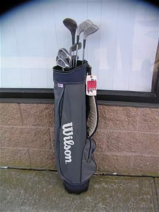 Golf club set includes a Wilson bag, Northwestern irons