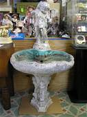 Antique seashell shaped bird bath