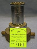 Antique brass fire nozzle by Elkhart brass company