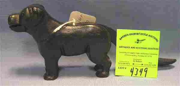Cast iron figural dog shaped nut cracker