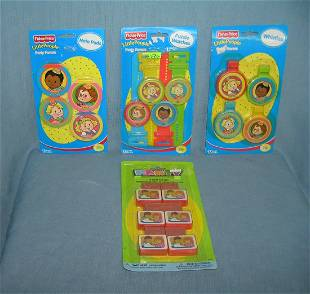 Group of vintage toys includes Fisher Price