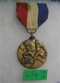 One mile relay runner's award medal and ribbon