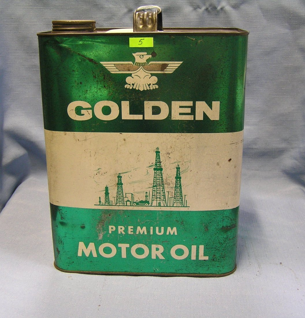 Golden motor oil can with oil truck and oil derricks