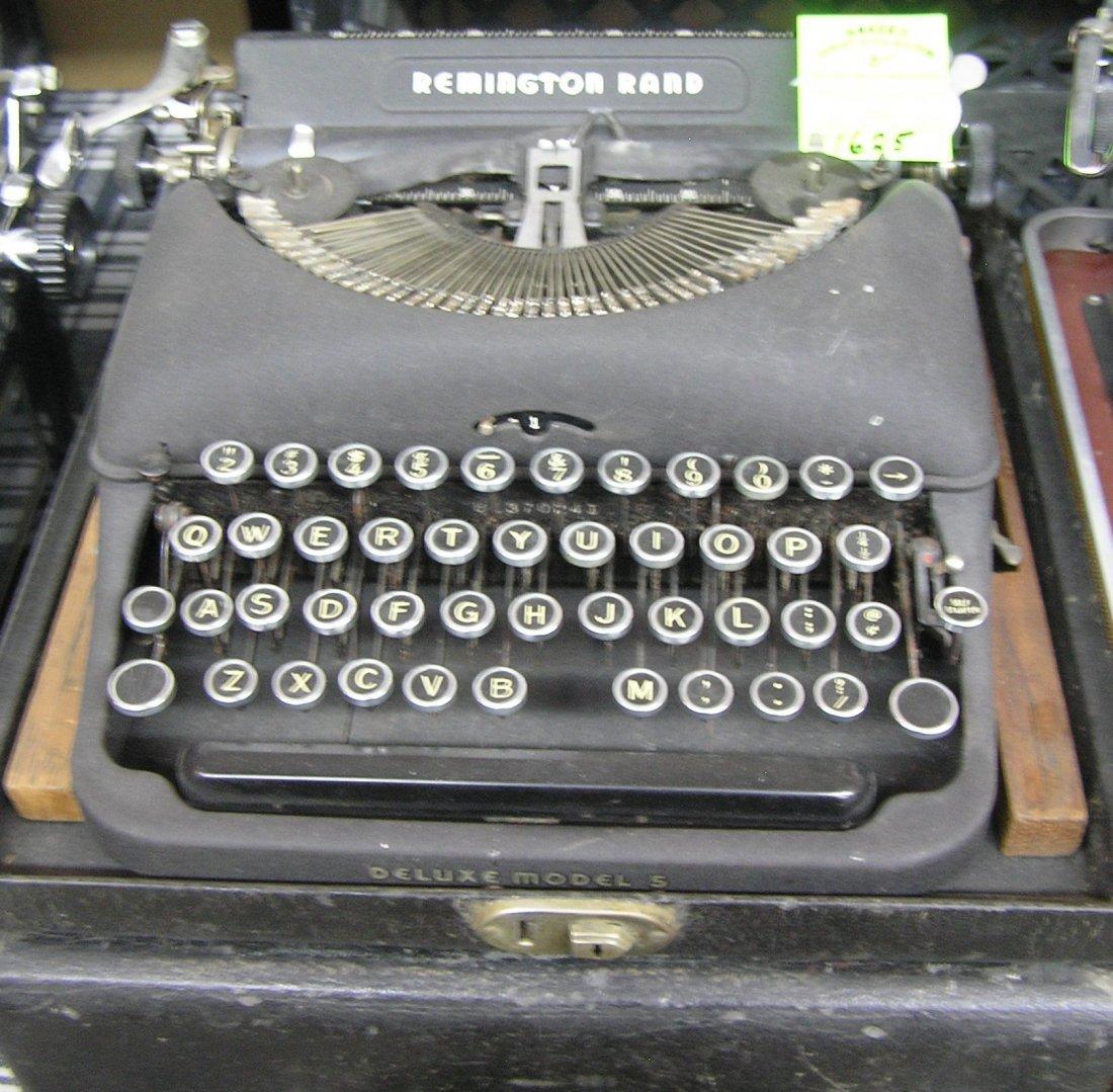 Antique Remington Rand typewriter with original case