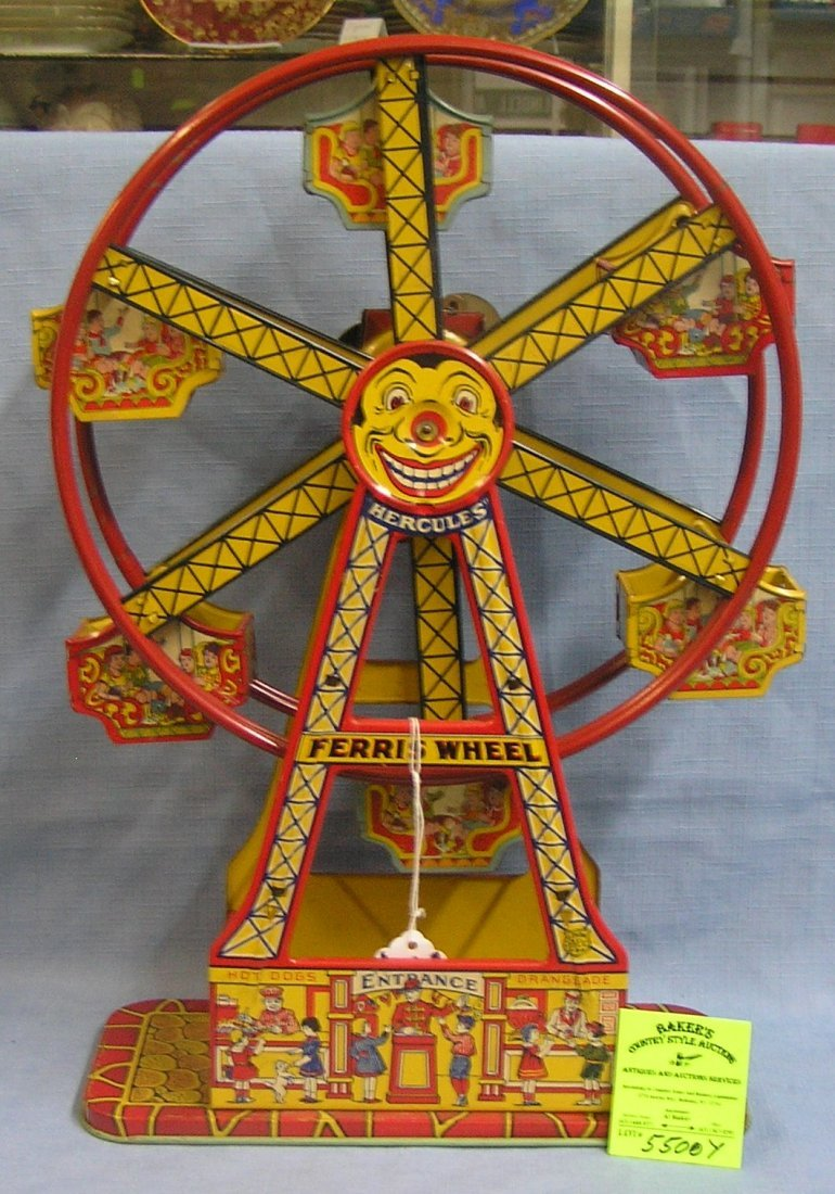 Early all tin windup mechanical Ferris wheel toy