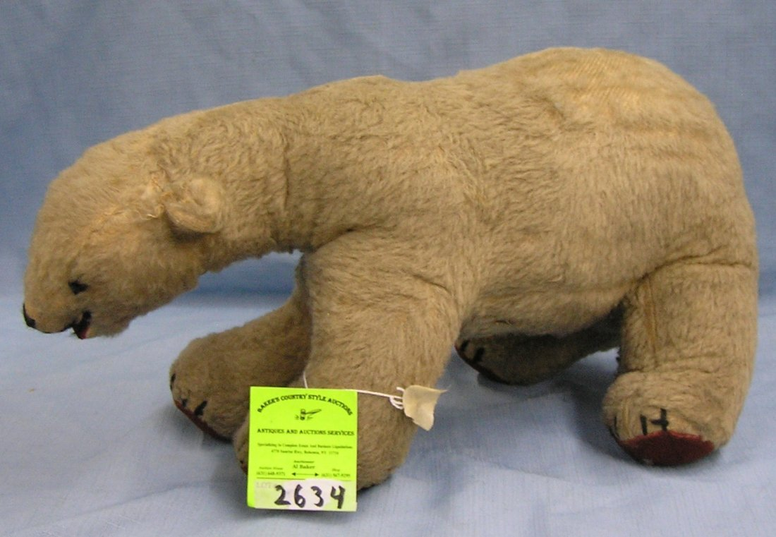Antique straw stuffed polar bear toy