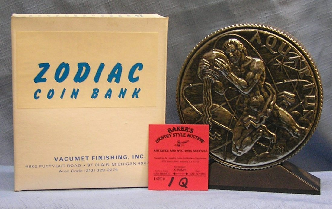 Vintage cast metal zodiac bank Aquarius