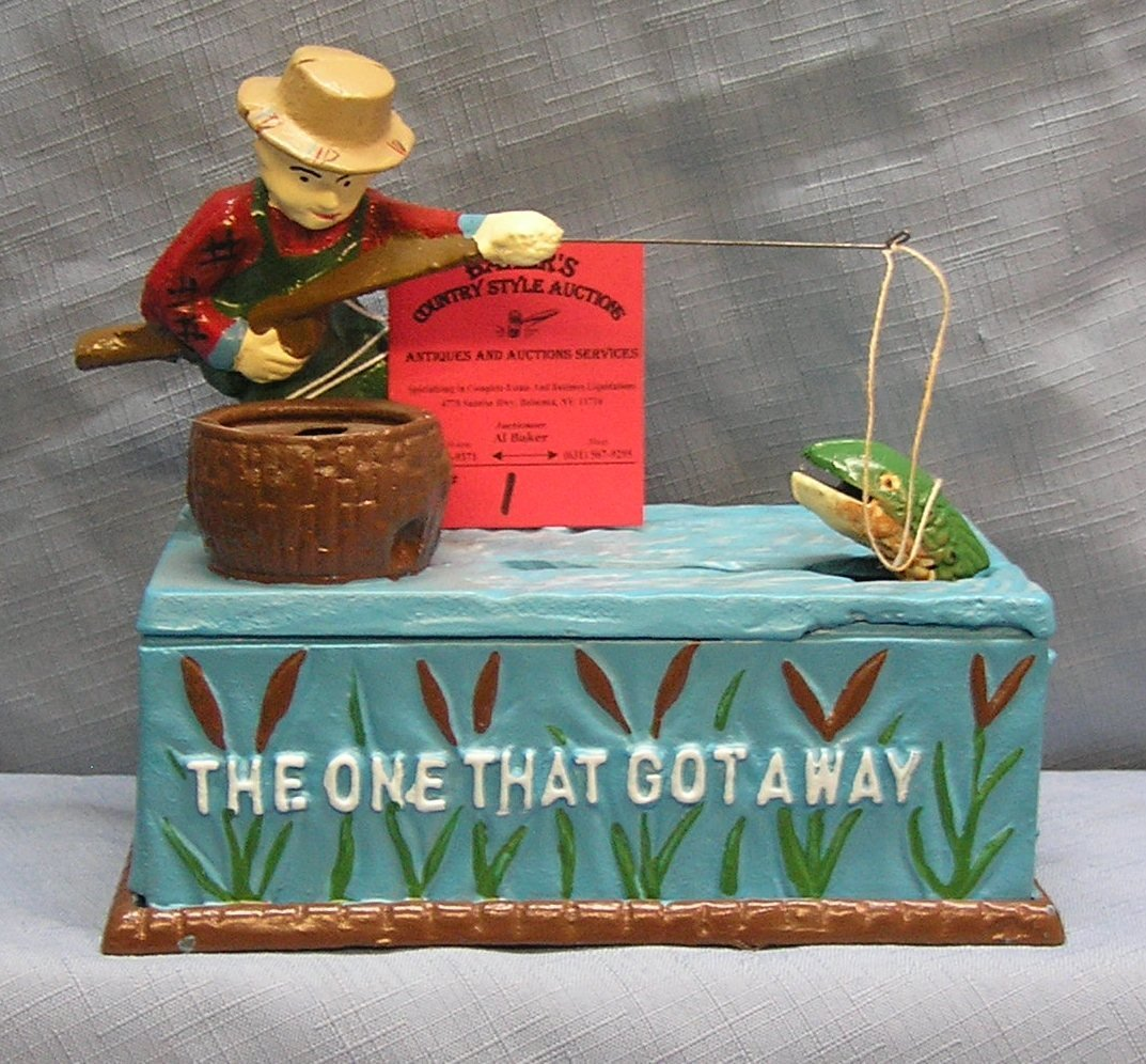 Hand painted cast iron fisherman mechanical bank