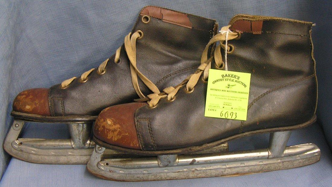 Pair of antique leather ice skates