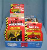 Box full of vintage Tonka toys and collectibles