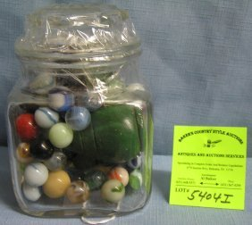 Glass Jar Full Of Marbles And Wooden Spinning Top