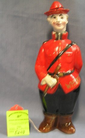 Figural Canadian Mounted Policeman Liquor Decanter