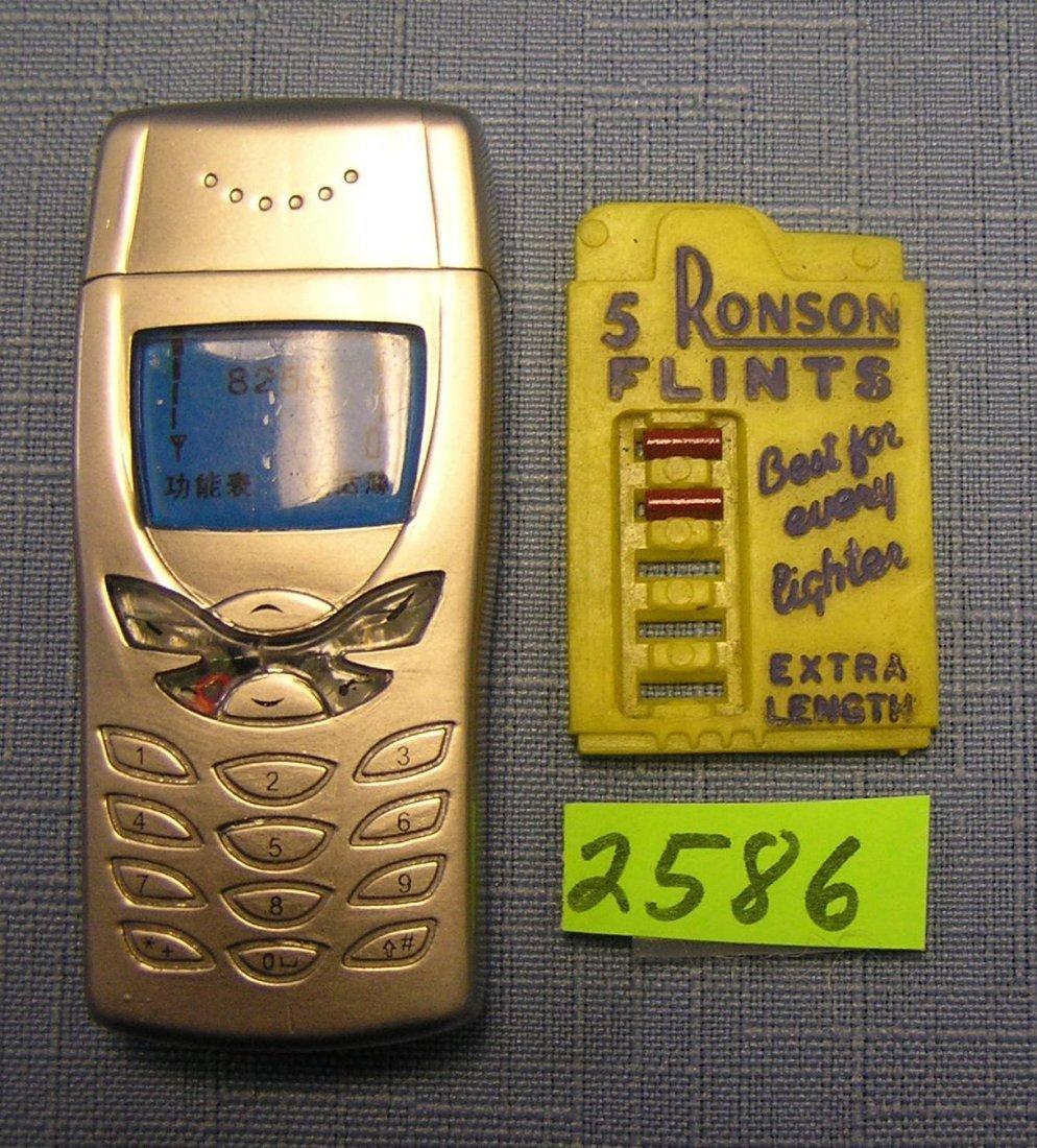 Butane cigarette lighter and Ronson flint display