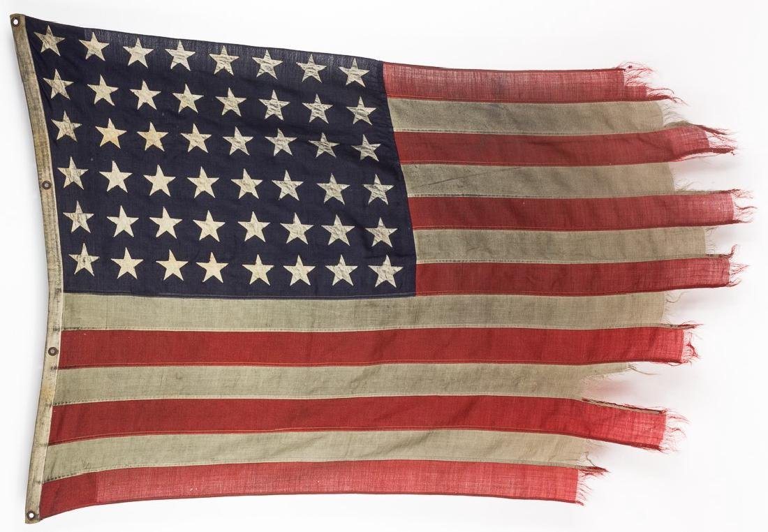AMERICAN FLAG FLOWN BY A LANDING CRAFT AT OMAHA BEACH