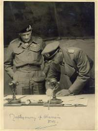 A PHOTOGRAPH OF THE GERMAN SURRENDER SIGNING AT