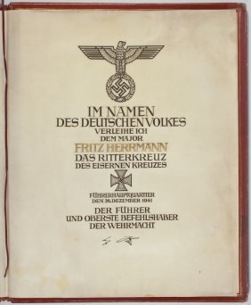 2: ADOLF HITLER AWARDS THE KNIGHT'S CROSS OF THE IRON C
