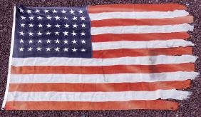 THE LAST AMERICAN FLAG TO LEAVE WAKE ISLAND BEFORE ITS