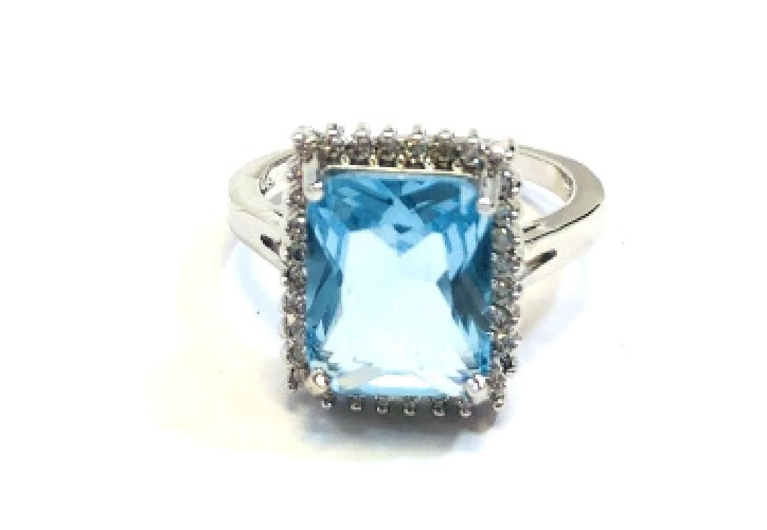 BEAUTIFUL BRIGHT BLUE TOPAZ GEMSTONE RING