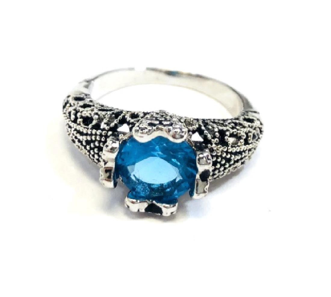 ELEGANT RAISED SET ROUND 1CT BLUE TOPAZ RING