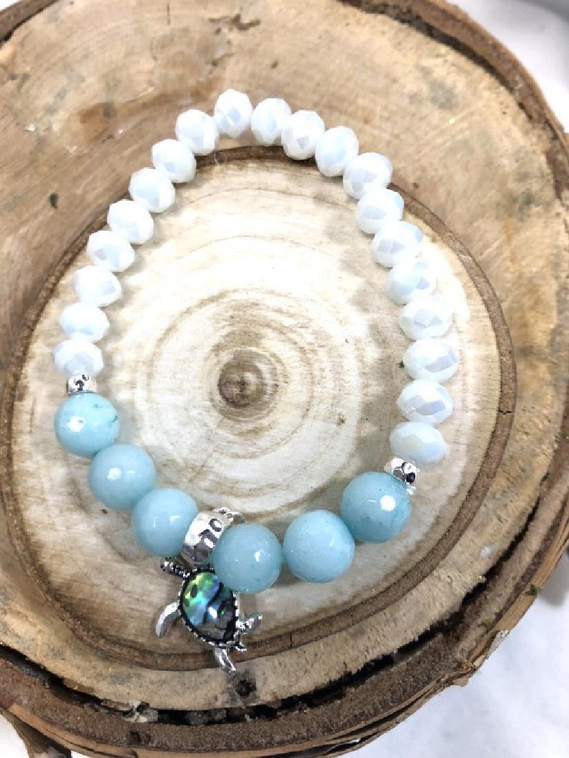 TURTLE CHARM TEAL AND WHITE BEADED BRACELET