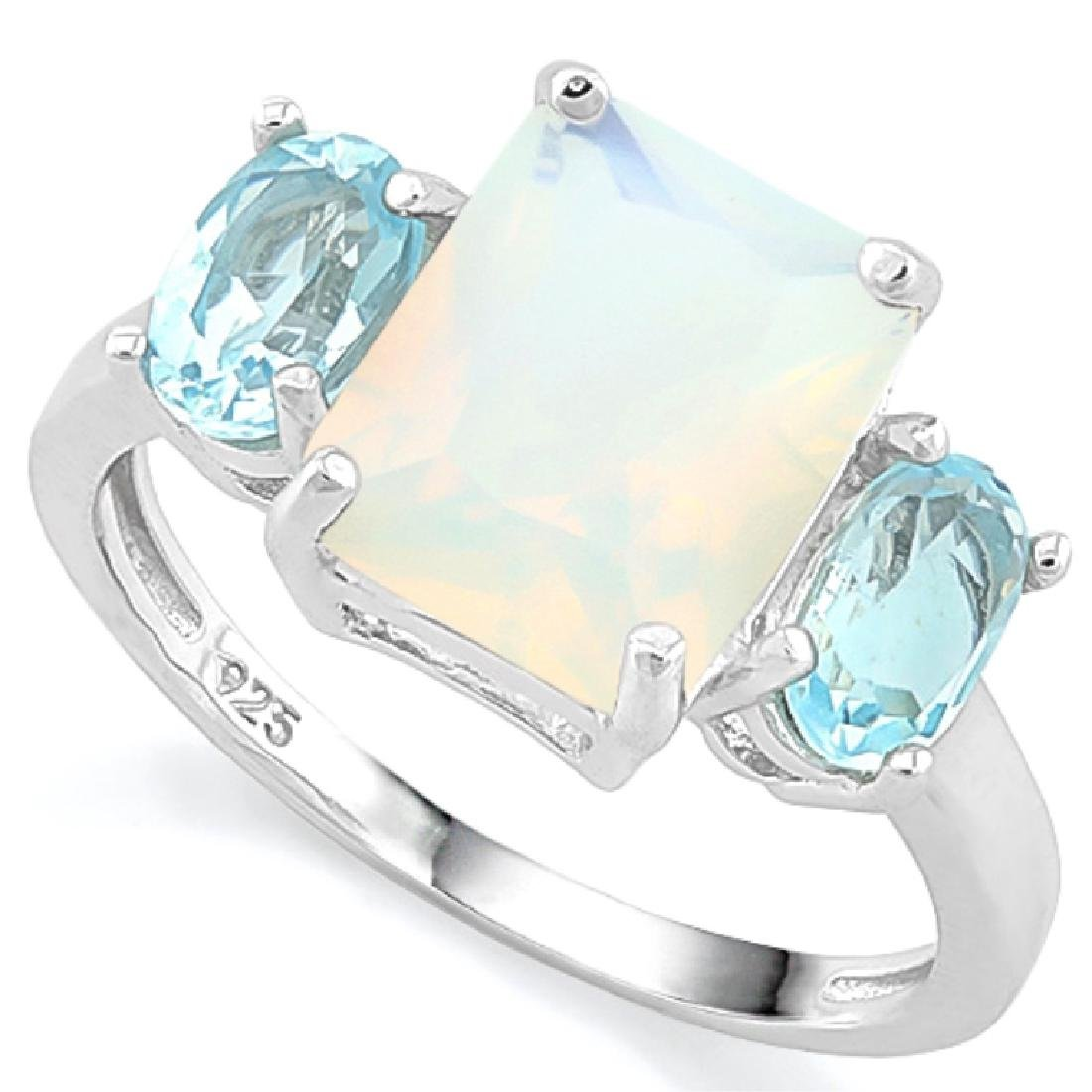 BEAUTIFUL BLUE TOPAZ ACCENT/FIRE OPAL STERLING RIG