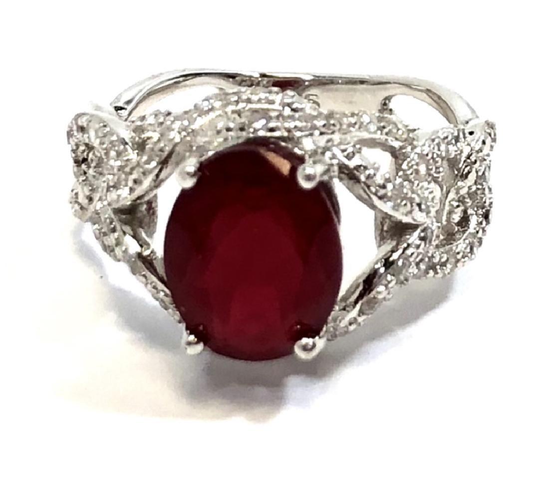 PRETTY 3CT OVAL FACETED CUT GARNET/DIAMOND RING