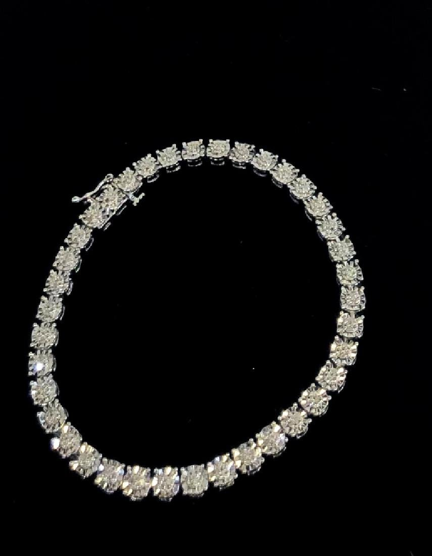 EXQUISITE DIAMOND ENCRUSTED STERLING TENNIS BCLT