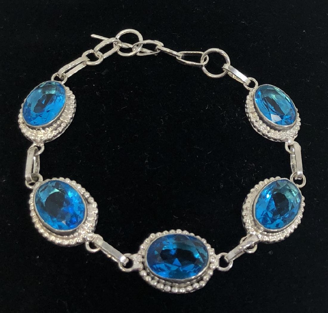 FABULOUS FACETED 15CT BLUE TOPAZ OVAL STONE BRACLT