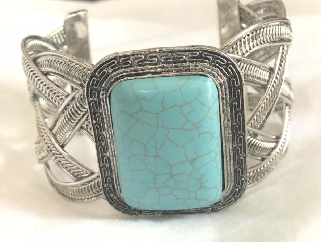 TRENDY TURQUOISE ACCENT CRISS CROSS BANGLE