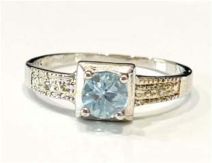 LOVELY BLUE TOPAZ .50CT ROUND SET SOLITAIRE RING