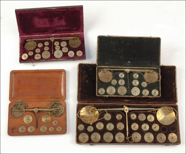 121: FOUR CASED EUROPEAN COIN BALANCES.