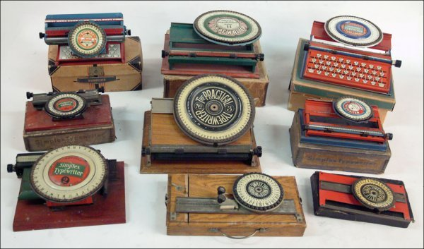 266: COLLECTION OF NINE SIMPLEX TOY TYPEWRITERS.