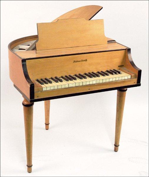 317: WURLITZER STUDENT BUTTERFLY PIANO.