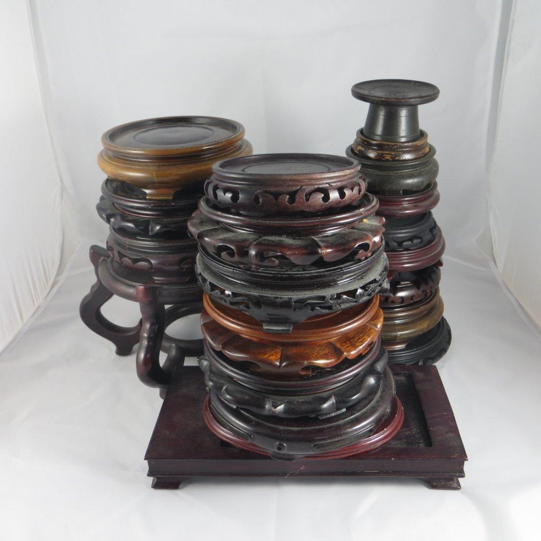 Twenty-three Chinese Wood Stands
