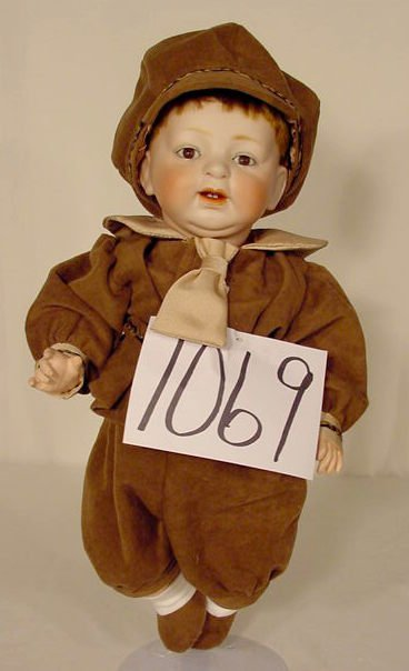 1069: Bisque Head Doll Marked Germany 211 JDK NR
