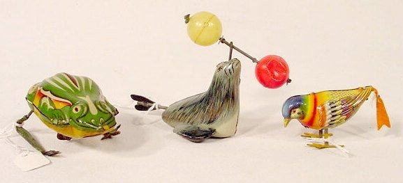2008: 3 Tin Litho Key wind Toys  NR